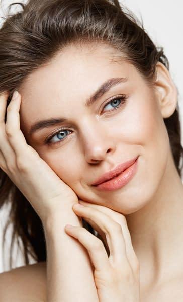 beautiful-young-woman-smiling-white-facial-treatment.jpg